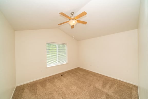 Vaulted Ceiling With Fan in Master Bedroom at Lynbrook Apartments and Townhomes in Elkhorn, NE