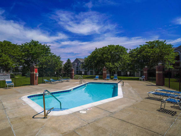 Outdoor Swimming Pool with Steps at Foxwood and The Hermitage, Portage, Michigan