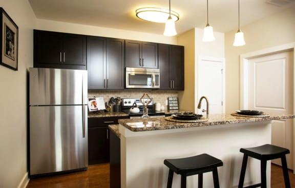 kichen with maple cabinetry and granite countertops