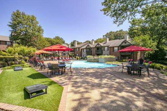 Inviting Swimming Pool with Fountain and Sundeck with Lounge Chairs and Tables for Relaxing at The Edge of Germantown Apartments Home, Memphis, TN 38120