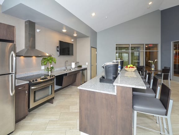 Clubhouse Kitchen with Large Kitchen Island and Bar Stool Seating