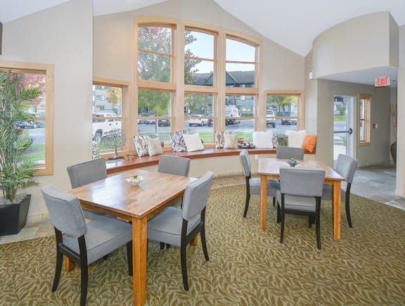 Tables and Chairs at the Clubhouse with Large Windows