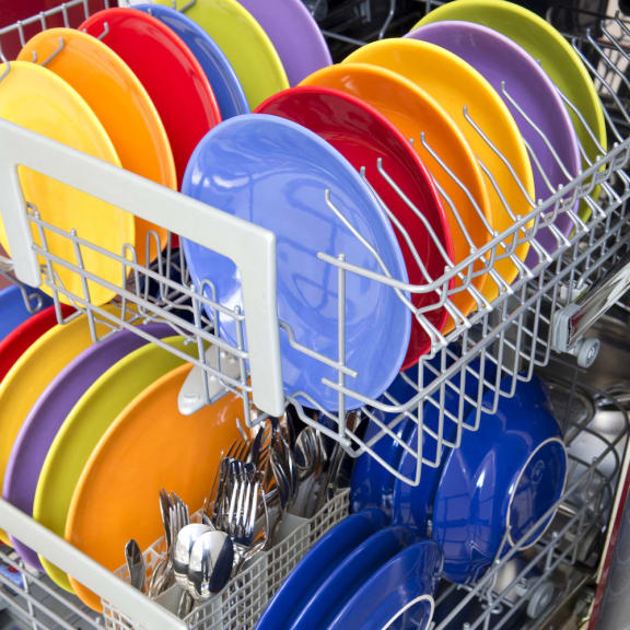 Dishwasher full of plates and silverware_The Crossings at Cape Coral Cape Coral, FL