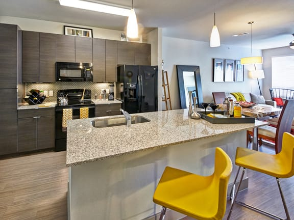 Open Concept Kitchen with Island and Breakfast Bar at Dallas Apartment Near Oak Lawn