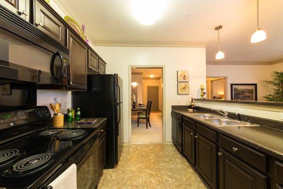 Galley Kitchen with Black Appliances