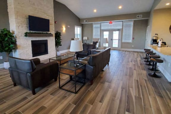 Clubhouse with Fireplace at Strathmore Apartment Homes, West Des Moines 50266
