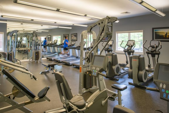 fitness center with machines at Amberleigh apartments in Fairfax VA