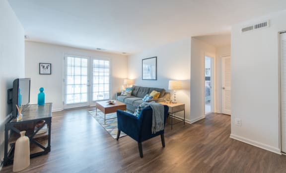 renovated living room with hardwood flooring at Amberleigh apartments in Fairfax VA