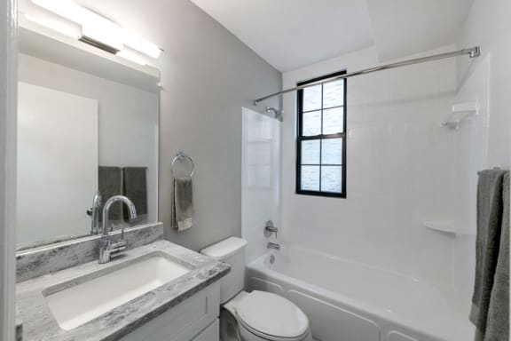 granite vanity and backsplash bathroom sink and shower at Connecticut Plaza Apartments, 2901 Connecticut Ave NW, Washington, District of Columbia, 20008