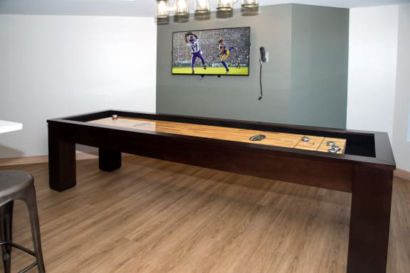 Gaming Area with Shuffleboard table at Aspenwoods Apartments, Eagan