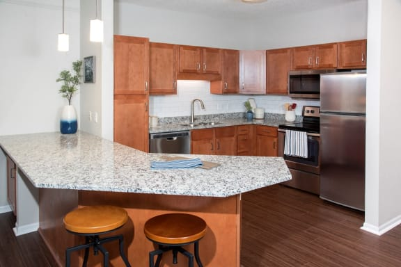 Large Kitchen with Cabinetry and Appliances at Waterstone Place, Minnetonka, MN, 55305