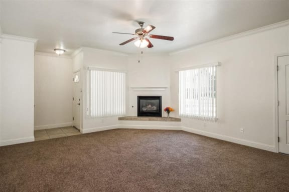Living Room with Fireplace at Dartmouth Tower at Shaw, Clovis, CA