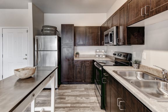 ABQ Uptown Apartments - Kitchens with stainless steel or black appliances