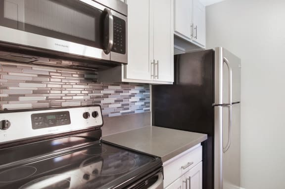 Modern Kitchen with Utilities at Pacific Trails Luxury Apartment Homes, Covina, CA