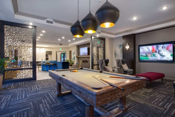 Clubroom with Kitchen and Fireplace at The Flats at Ballantyne Apartments, Charlotte, NC, 28277