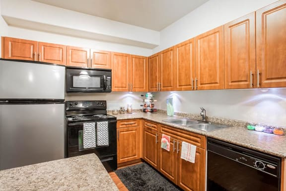 Fully Equipped Kitchen Includes Frost-Free Refrigerator, Electric Range, & Dishwasher at The Preserve at Rock Springs, Rock Springs, 82901