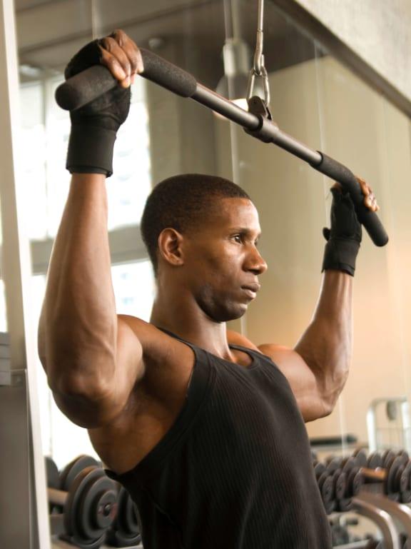Man using exercise machines_Cornerstone Village Pittsburgh, PA