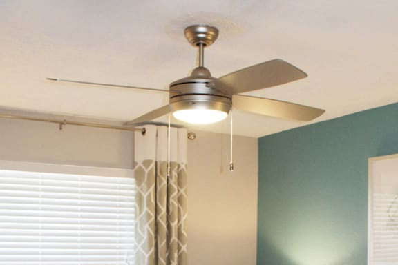 modern ceiling fan in apartment bedroom at The VUE at Crestwood Apartments, Birmingham, AL
