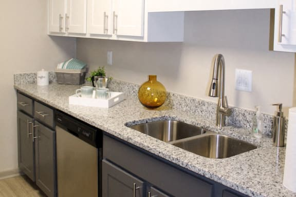 granite kitchen counter with decor at The VUE at Crestwood Apartments, Birmingham