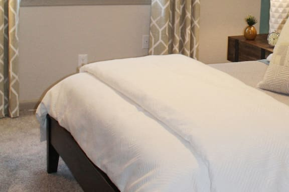 furnished bedroom with plush carpeting at The VUE at Crestwood Apartments, Birmingham, 35212