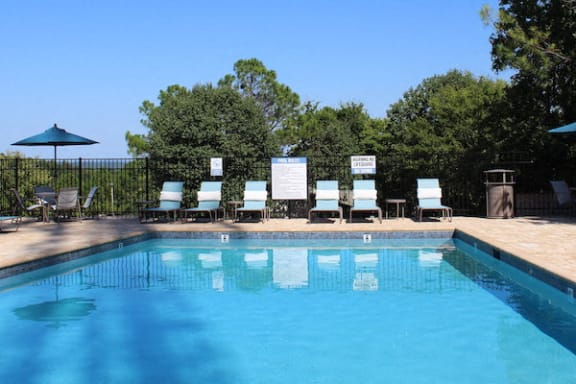 sparkling pool with lounge furniture at The VUE at Crestwood Apartments, Alabama