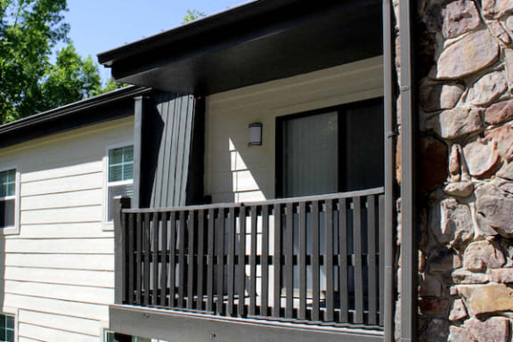 private deck with wooden railing at The VUE at Crestwood Apartments, Alabama
