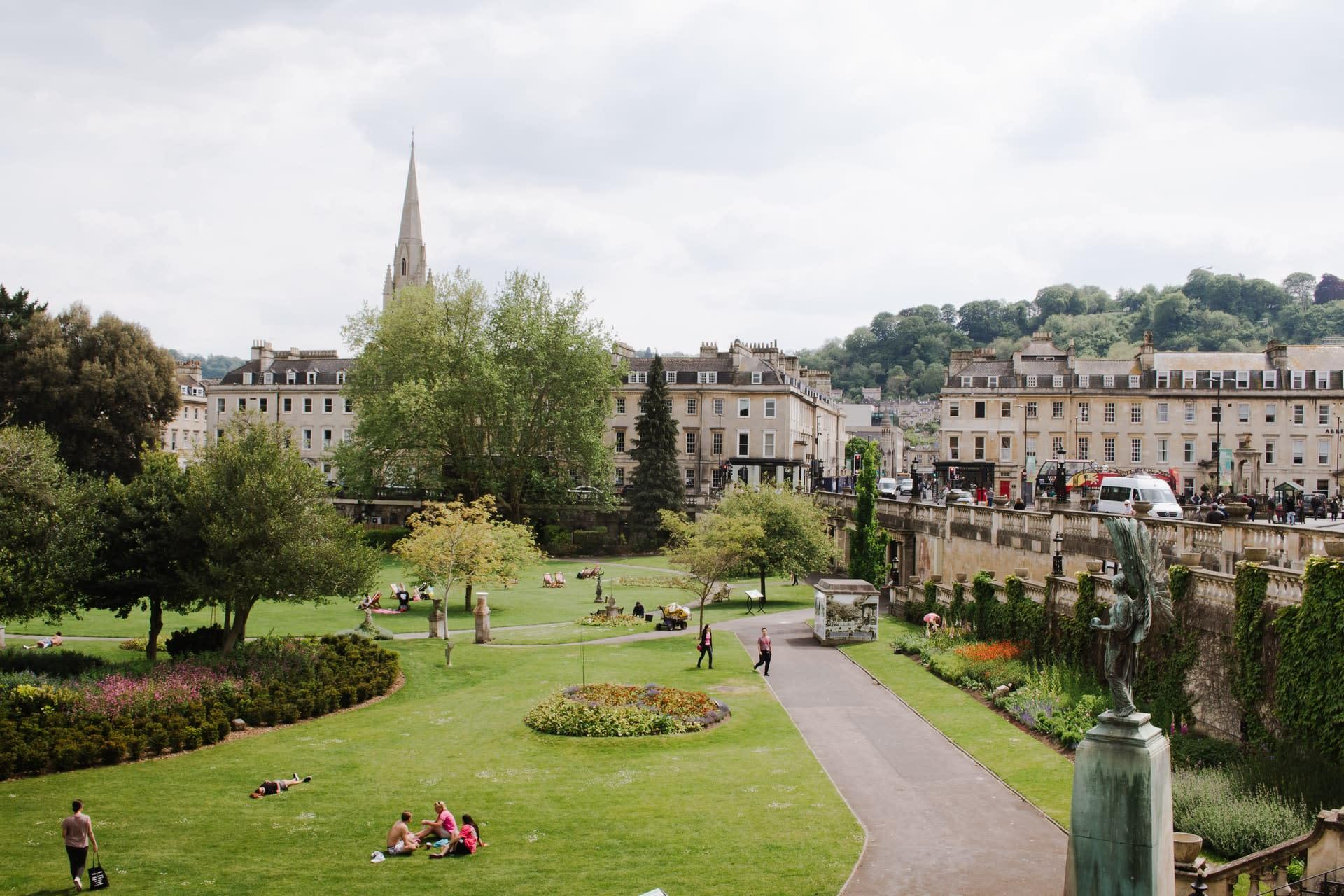 People relaxing in park in Bath