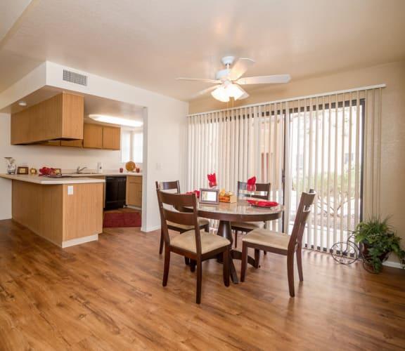 Casas Lindas open kitchen and dining area near the backyard sliding door
