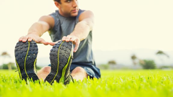 Man Stretching Before Going Running at Foothill Lofts Apartments & Townhomes, Logan, UT, 84341