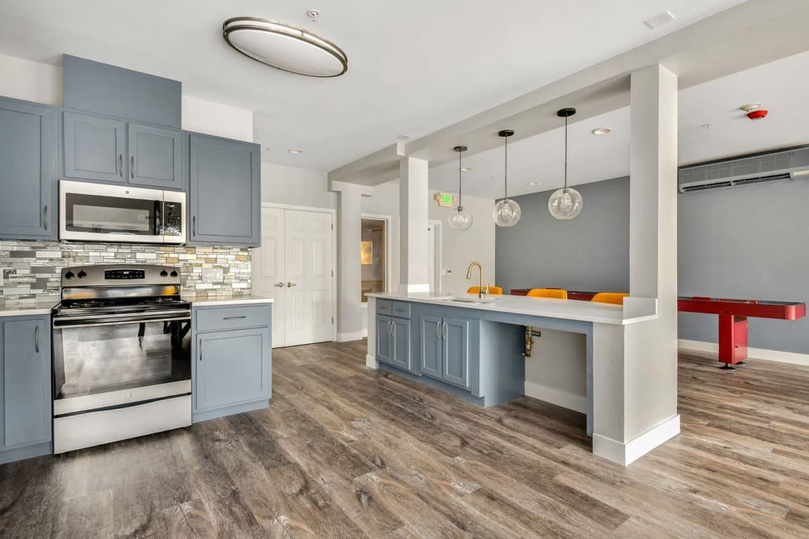 lounge with fully furnished kitchen at pet friendly reunion at redmond ridge - an active adult community