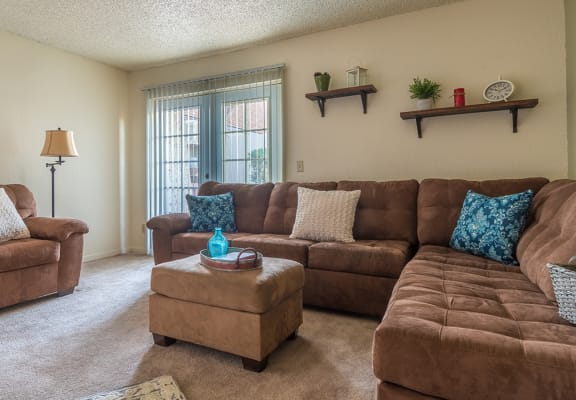 Somerpointe living room with plenty of couches and lounging space with carpet flooring