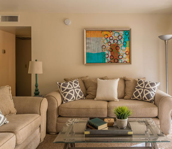 Cantera living rooms with private balconies and sliding glass door