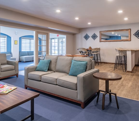 canyon oaks clubhouse with cozy couches and fireplace