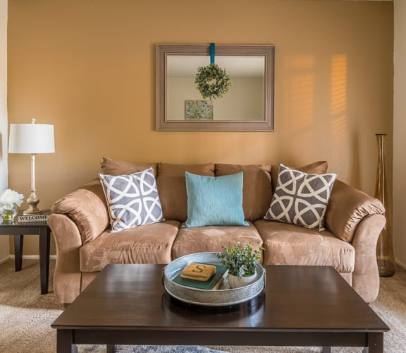 Foothills living room with carpet flooring and a cozy couch