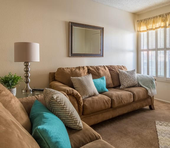 Riverstone living room with couches, carpet flooring and nice natural lighting