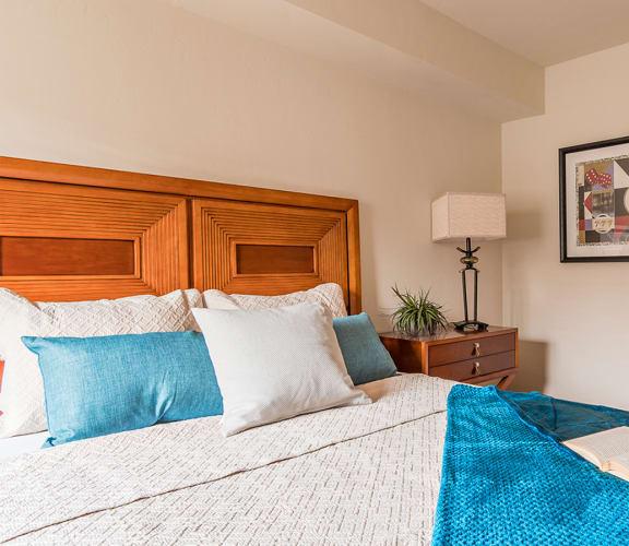 El Dorado Place bedroom with view into bathroom.