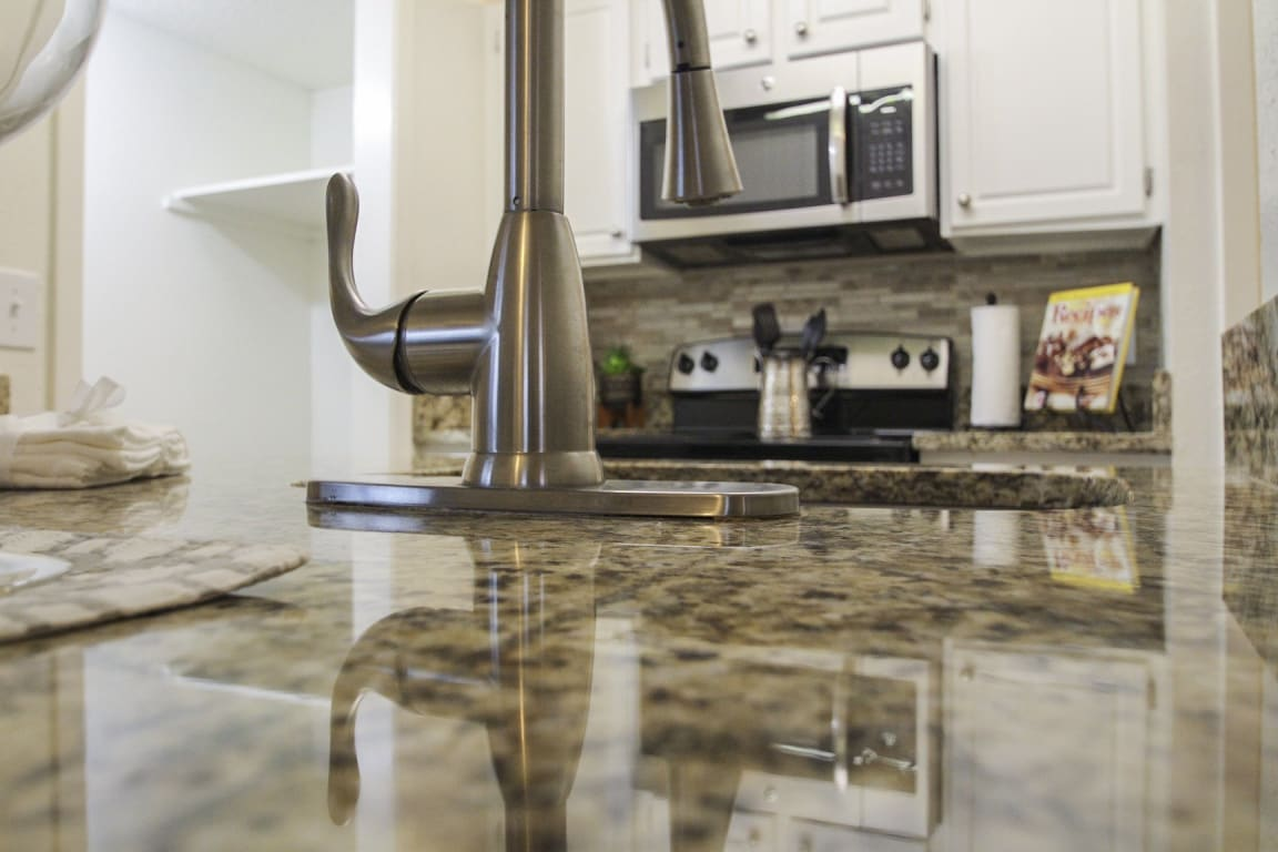 This is a photo of the kitchen of a 1245 square foot 2 bedroom apartment at Cambridge Court Apartments in Dallas, TX.