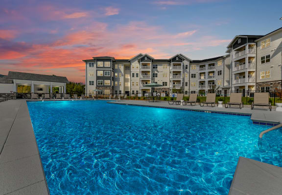 Sunset look at the outdoor swimming pool at The Station at Brighton apartments in Grovetown, GA