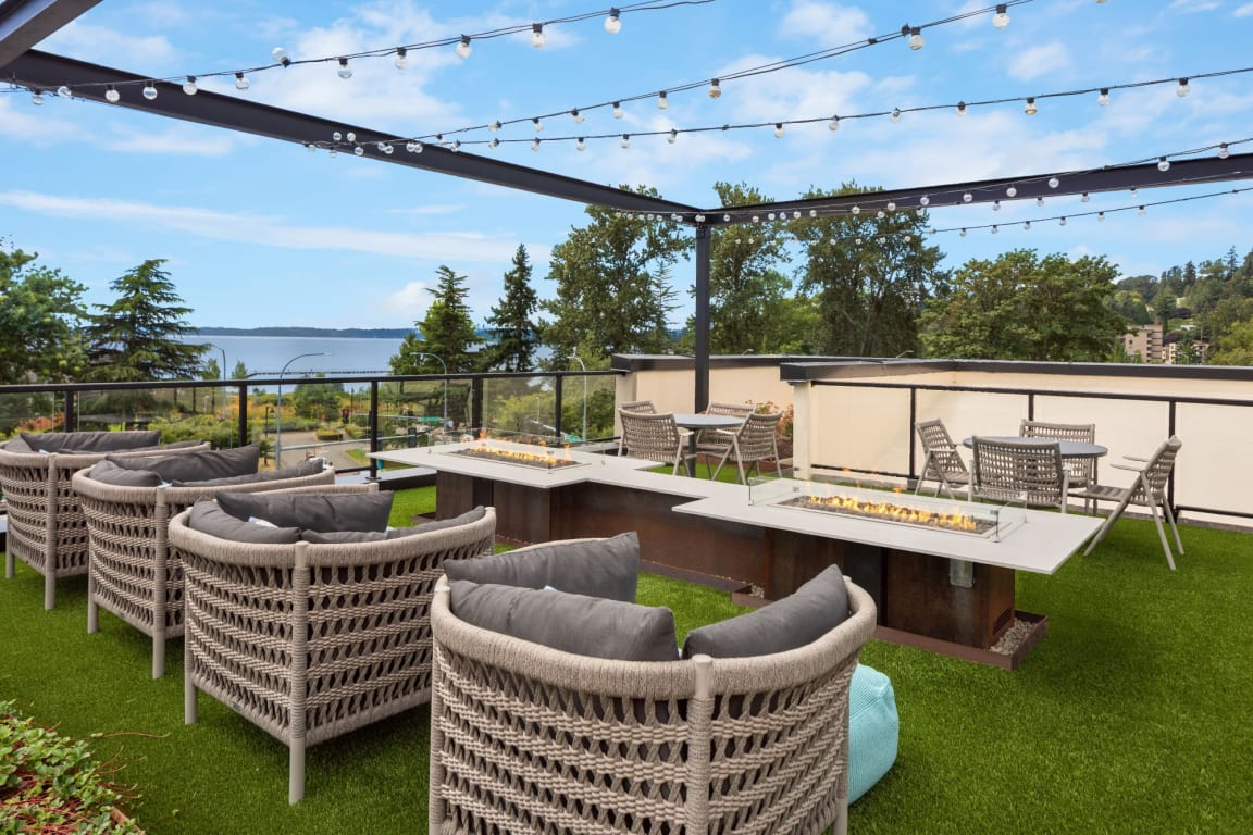 Waterscape at Juanita Village Apartments Rooftop Patio with Firepits and Chairs