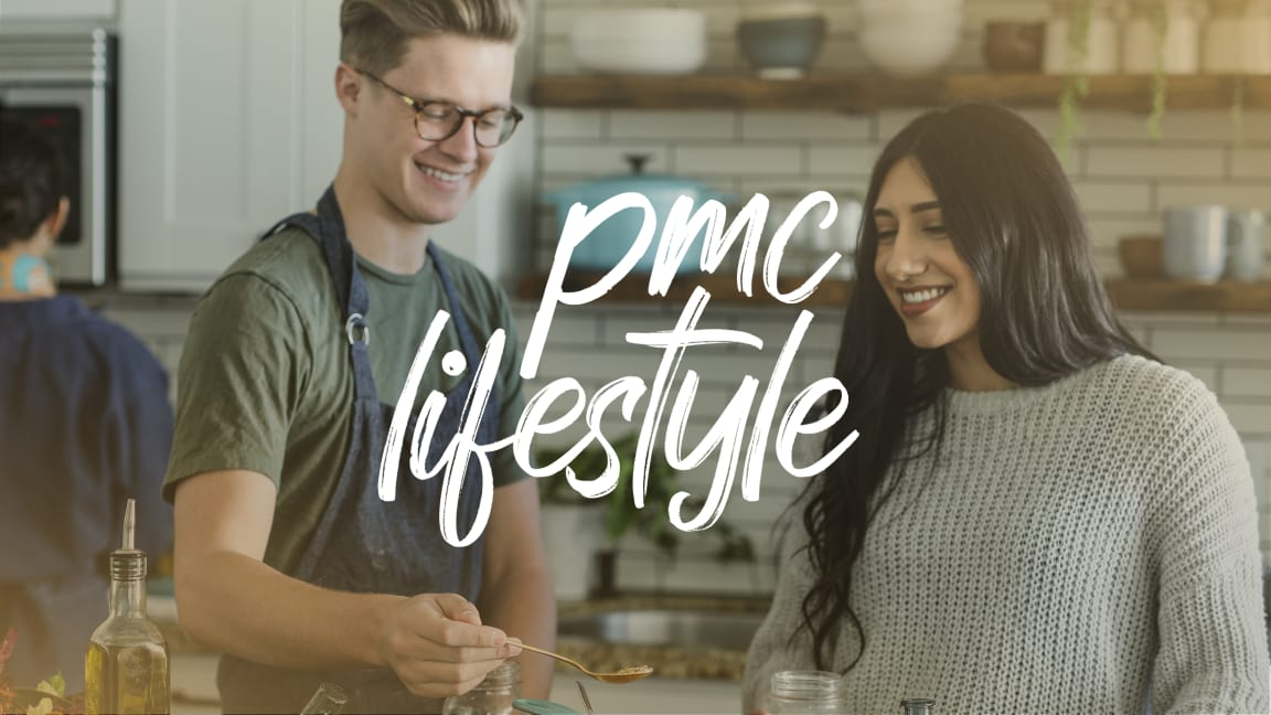 """""""PMC Lifestyle"""" text on top of an image of a young man cooking in a kitchen with a young woman"""
