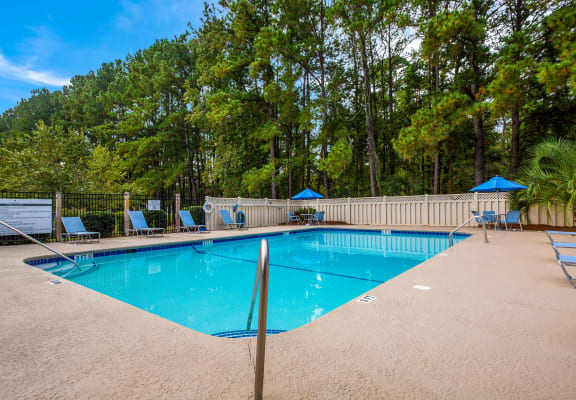 Sparkling outdoor swimming pool at Kessler Point Apartment Homes in Garden City, GA