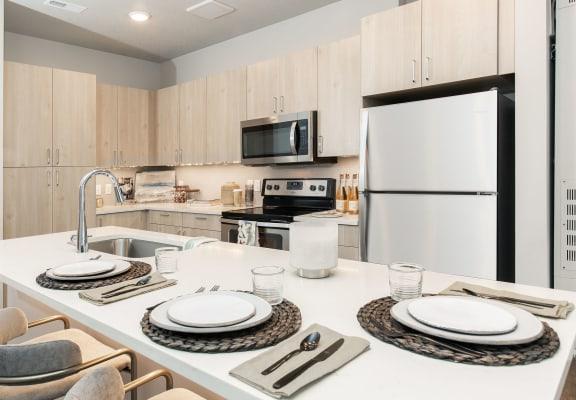 Eat-In Kitchen Table With Sink at Soleil LoftsApartments, Herriman, Utah