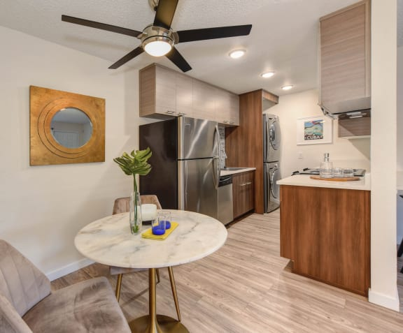 Kitchen Stove with microwave above.  Views of the dining area and living room.