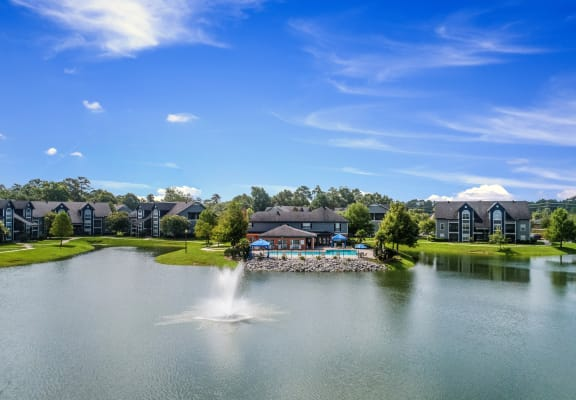 Aerial view of the property looking over the lake towards the pool and clubhouse at Pelican Pointe in Slidell, LA