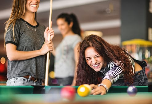 friends playing pool in community recreation room at Crescent Centre Apartments, Louisville Kentucky