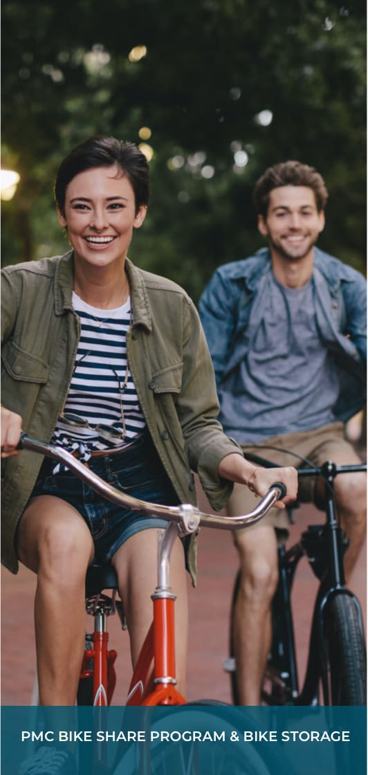 """a young woman and young man on bikes underneath some trees and text that says """"PMC Bike Share Program & Bike Storage"""""""