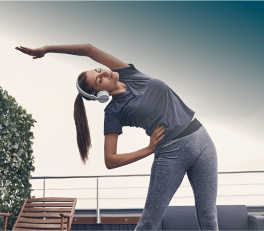 a woman stretching on a building deck