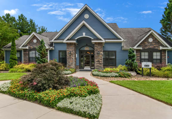 Exterior of the clubhouse at Heritage at Riverstone Apartments in Canton, GA