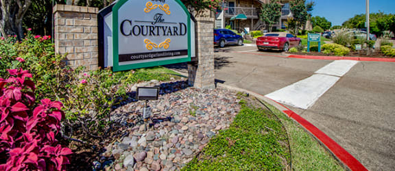 Main entrance to The Courtyard Apartments in Garland TX
