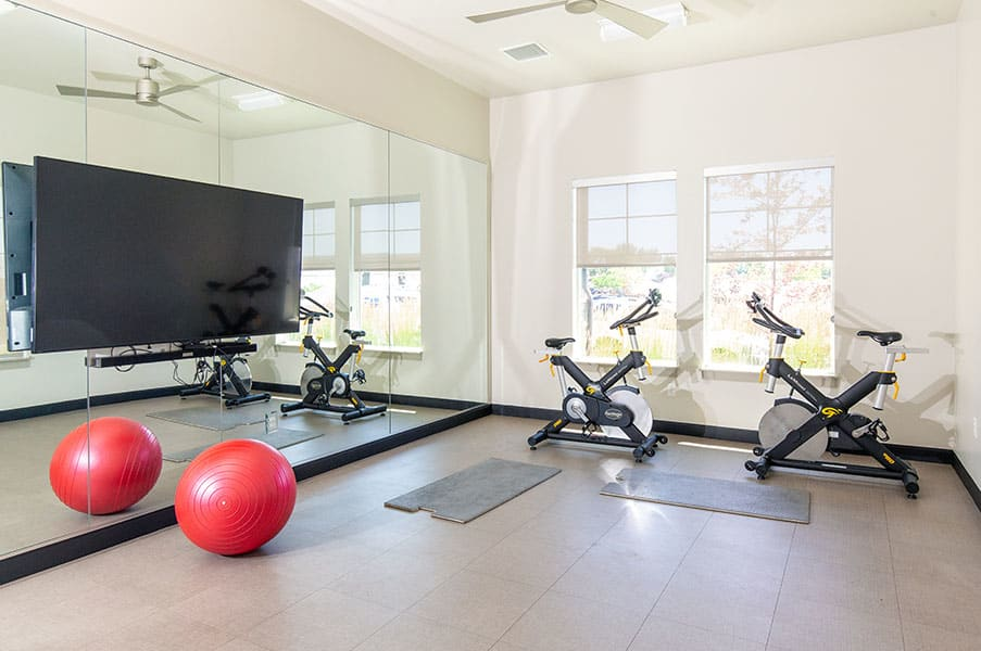 Fitness Center With Updated Equipment at Parc on CenterApartments& Townhomes, Utah, 84057